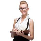Femme d'affaires tenant le journal intime Images libres de droits