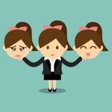 Femme d'affaires tenant le visage heureux et triste d'émotions Image libre de droits
