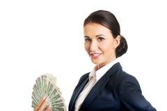 Femme d'affaires tenant une agrafe d'argent polonais images stock