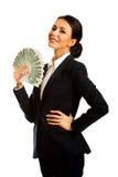 Femme d'affaires tenant une agrafe d'argent polonais Photographie stock libre de droits