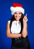 Femme d'affaires utilisant le chapeau d'une Santa Photos libres de droits