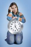 Femme d'horloge Photos libres de droits