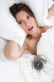 Femme d'horloge d'alarme photos libres de droits