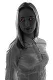 Femme d'imagination avec les yeux rouges Image stock