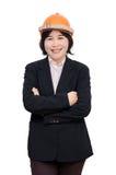 Femme d'ingénieur avec le casque au-dessus du blanc Image libre de droits