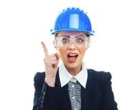 Femme d'ingénieur au-dessus du fond blanc Image libre de droits