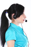 Femme d'opérateur à un centre d'attention téléphonique image stock