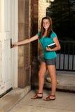 Femme d'université allant classer Images libres de droits