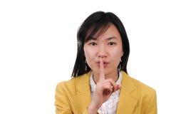 femme d'utilisation de signal de shhhhh de langage de main de l'Asie Image stock