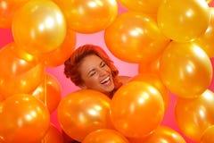 Femme dans ballons Image stock