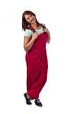 Femme dans des combinaisons rouges, d'isolement sur le blanc Photos libres de droits