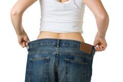 Femme dans des jeans trop grands photos libres de droits