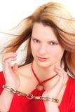 Femme dans des menottes Images stock