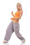 Femme dans des vêtements oranges faisant la forme physique Photos stock
