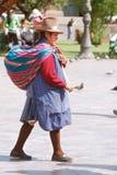 Femme dans des vêtements typiques Image stock