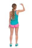 Femme dans des vêtements vibrants de sports écrivant la vue arrière Images libres de droits