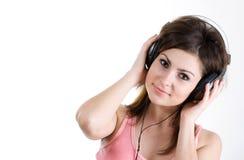 Femme dans l'écouteur Photo stock