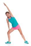 Femme dans l'étirage vibrant de vêtements de sports Photo libre de droits