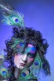 Femme dans l'image de paon. Photos libres de droits
