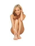 Femme dans l'undrewear de coton touchant ses jambes images stock