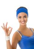 Femme dans l'usure de sports faisant des gestes, d'isolement Photos libres de droits