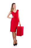 Femme dans la caisse rouge de robe et de voyage Images stock