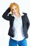 Femme dans la jupe et des jeans Photographie stock libre de droits