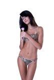Femme dans la lingerie et bas corps de poids tenant une fleur Images libres de droits