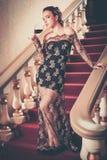 Femme dans la longue robe de soirée Image stock