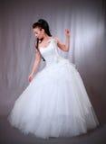 Femme dans la robe de mariage. Image stock