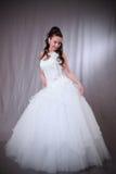 Femme dans la robe de mariage. Photos stock