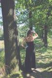 Femme dans la robe noire Images libres de droits