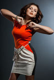 Femme dans la robe orange photos stock