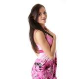 Femme dans la robe rose avec l'appareil orthodontique Photos libres de droits