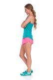Femme dans la vue de côté de vêtements vibrants de sports d'isolement Image libre de droits