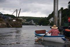 Femme dans le bateau Photos stock