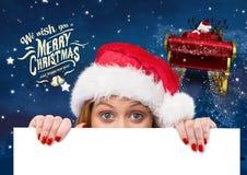 Femme dans le chapeau de Santa tenant la plaquette 3D Photographie stock