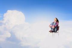 Femme dans le ciel Photographie stock libre de droits