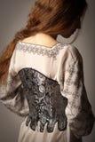 Femme dans le corset Images stock