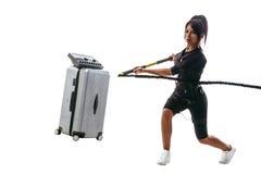 Femme dans le costume de SME faisant l'exercice de mouvement brusque Photographie stock libre de droits