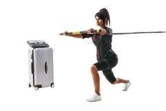 Femme dans le costume de SME faisant l'exercice de mouvement brusque Photographie stock