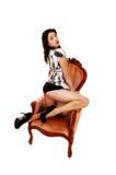 Femme dans le fauteuil. Image stock