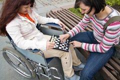 Femme dans le fauteuil roulant Photographie stock