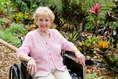 Femme dans le fauteuil roulant avec Copyspace Photographie stock