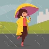 Femme dans le manteau jaune Photographie stock