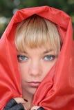 Femme dans le manteau rouge Photos stock