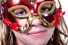 Femme dans le masque rouge sur carnaval Photo stock