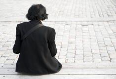Femme dans le noir Photo stock