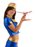 Femme dans le procès bleu avec de petits aéronefs, sideview Image stock