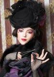 Femme dans le rétro style. Image stock